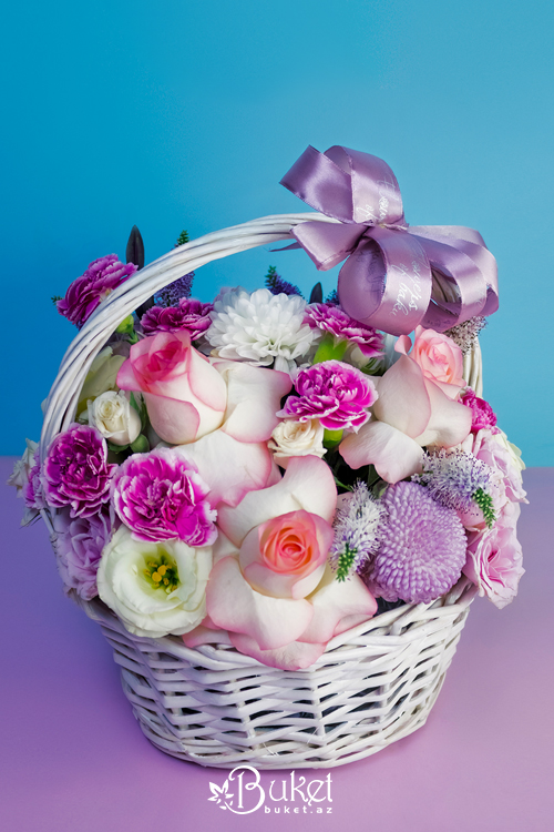 Rose composition in a wicker basket